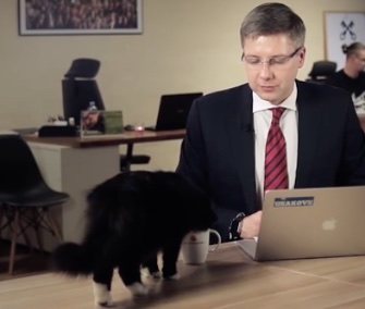 A Latvian mayor's cat interrupted his interview to try his tea.